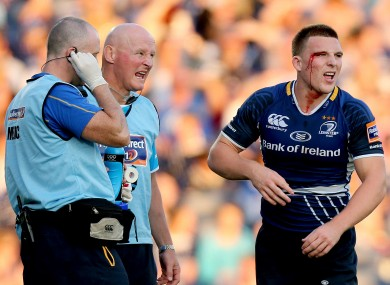 Ouch: Andrew Conway is treated for an eye injury