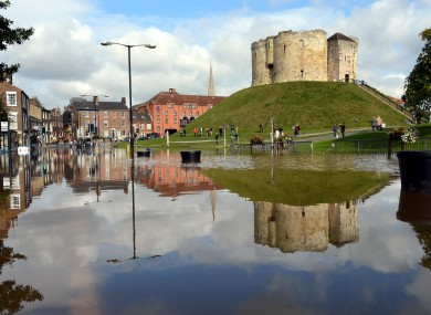 Cliffords Tower, one of York's famous ancient attractions is reflected in floodwater which this morning filled surrounding City Centre roads.