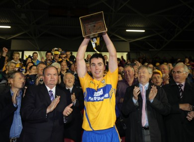 Clare captain Conor McGrath lifts the cup.