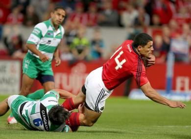 Munster's Doug Howlett scores the first try despite the attenions of Treviso's Simone Favaro.