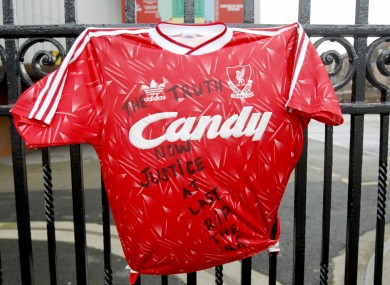 A replica of a previous Liverpool FC shirt is attached to the railings outside Anfield Stadium today.