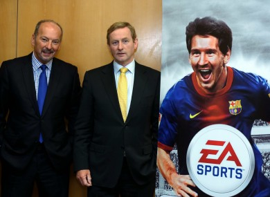 Enda Kenny with EA's chief operating officer Peter Moore - and a cardboard Lionel Messi - at the jobs announcement in Dublin today.