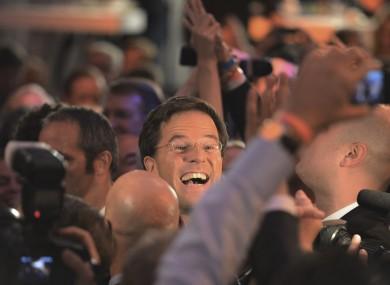 Dutch prime minister Mark Rutte greets supporters last night