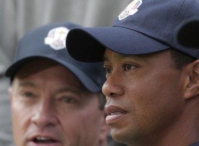 USA's captain Davis Love III and Tiger Woods pose for a photo at the Ryder Cup PGA golf tournament.