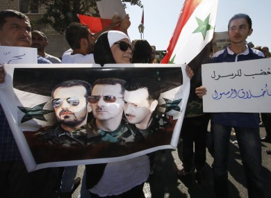Pro-Assad supporters chant slogans during a demonstration in Damascus on Friday.