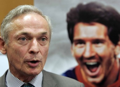 Jobs Minister Richard Bruton with a picture of football superstar Lionel Messi