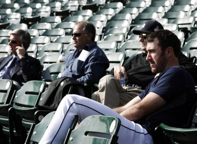 Detroit pitcher Justin Verlander, right, a workout with Tigers officials yesterday.