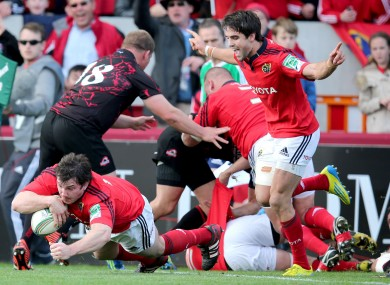 Conor Murray celebrates as Damien Varley dives over for the fourth try.