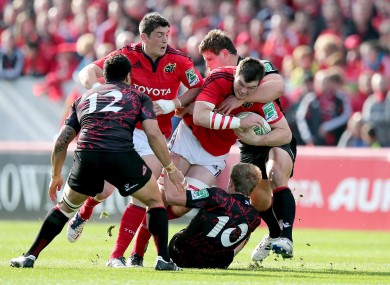 Peter O'Mahony of Munster is tackled by Ross Ford of Edinburgh.