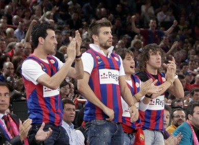 The Barcelona footballers cheer on their basketballing counterparts in 2010.