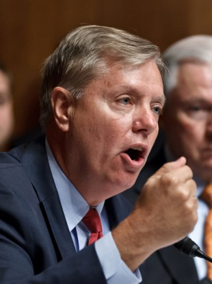 Republican senator Lindsey Graham (left) believes the Obama administration has played down details of a co-ordinated attack on a consulate in Libya last month.