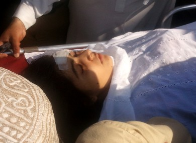 Malala Yousufzai being moved to a helicopter to be taken to Peshawar for treatment