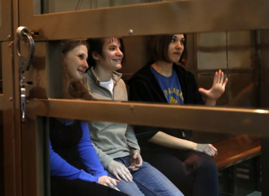 Three members of Pussy Riot in their glass cage during the court case in Moscow.