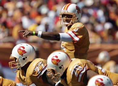 Tampa Bay Buccaneers quarterback Josh Freeman calls the play.