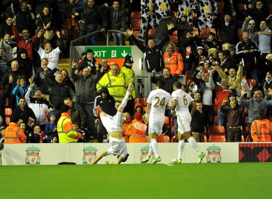 Swansea City's Chico (left) celebrates.