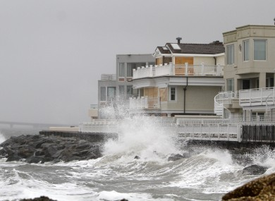 Waves crash onto the sea wall protecting homes in Longport, New Jersey yesterday