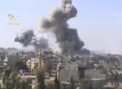 Image taken from video obtained from the Ugarit news network, shows smoke following heavy bombing in Deir el-Zour's Jbeileh neighborhood yesterday