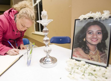Una Jones from Celbridge signs a book of condolence for Savita Halappanavar at the CityWest Convention Centre in Dubli