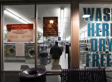 Wash, dry and vote - a Chicago Laundromat is used as a polling place.