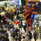 Shoppers wait on a check-out line in the Times Square Toys-R-Us store after doors were opened to the public at 8 p.m. on Thursday in New York. (AP Photo/John Minchillo)