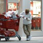 Poor Betsy McGonagle is all shopped out in Northeast Philadelphia. (AP Photo/ Joseph Kaczmarek)
