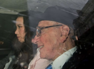 News Corp. chairman Rupert Murdoch and his wife Wendi Deng arrive at the High Court in London to give evidence to the Leveson Inquiry into phone hacking, Thursday, April 26, 2012.