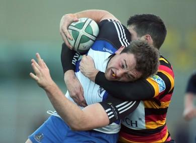 Lansdowne's Conor Toolan tackles Brian Hayes of Cork Con.