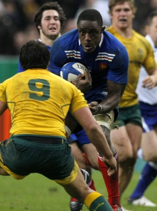 Yannick Nyanga of France charges at Australia's Nick Phipps last weekend.