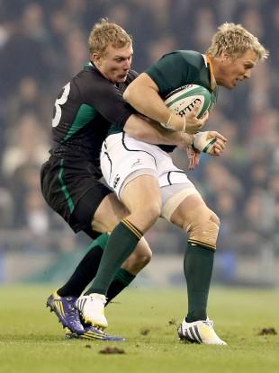 Springbok captain Jean de Villiers is tackled by Keith Earls.