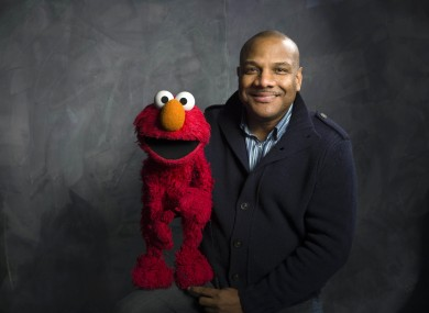 Kevin Clash and Elmo pictured in 2011