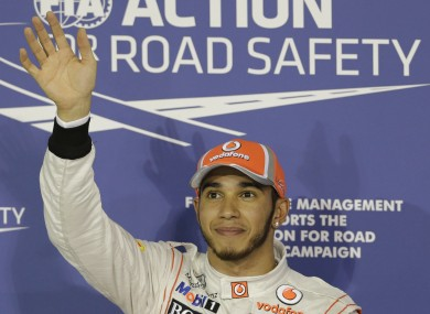 Lewis Hamilton smiles after securing pole position in the Abu Dhabi grand prix.