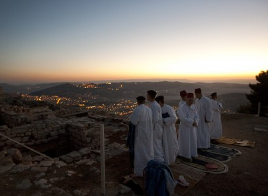 Members of the ancient Samaritan community, pray during the pilgrimage for the holy day of the Tabernacles or Sukkot