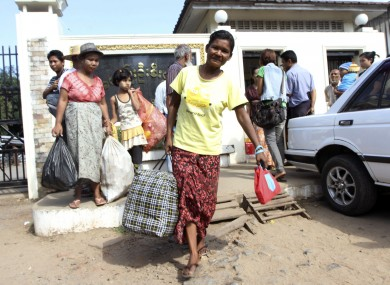 Myanmar prisoner walks outside Insein prison in Yangon, Myanmar after she was released today.