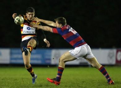 Clontarf's Niall Myron tackles Tom Daly of Lansdowne.