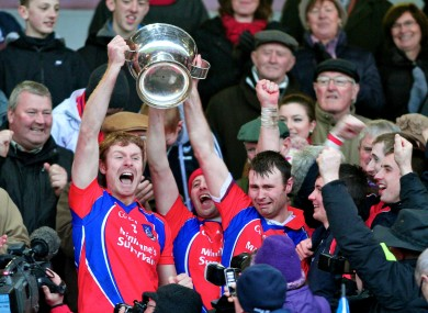 St. Thomas captain Robert Murray and his brother Richard lift the Tom Callanan Cup.