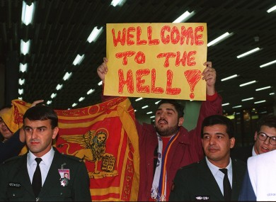 A Galatasaray fan reveals the now-infamous banner.