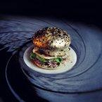 Gold tinfoil-wrapped buns, quail eggs, letuce, creme fraiche, mini-octopi.