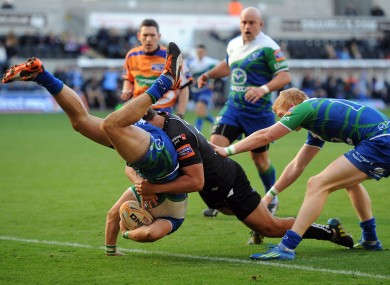 Connacht's Tiernan O'Halloran is tackled by Ashley Beck of Ospreys.