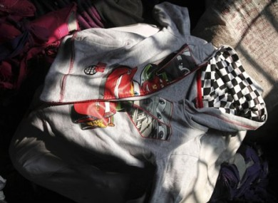 A Disney brand hoody lays among the equipment charred in the fire that killed 112 people.