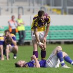 After over 140 minutes of football, Wexford and Longford are finally seperated. Wexford's Adrian Flynn tries to console Longford's Sean McCormack after the game. (INPHO/Cathal Noonan).