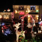 Liam Tilley from Bath Avenue near the Aviva Stadiuim in Dublin uses his Christmas lights display to raise money for Our Lady's Hospice in the city. Nice. (Niall Carson/PA Wire)