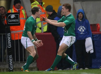 The duo celebrate after a Gilroy try for Ireland.