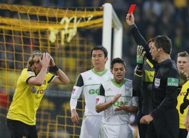 Marcel Schmelzer can't believe his German eyes as he is sent off.