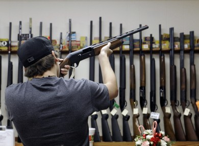A customer checks a shotgun at a shop in Texas