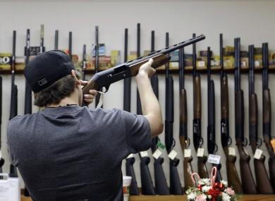 A customer checks a shotgun at a shop in Texas
