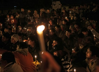 Indians hold a candle lit vigil for the 23-year-old medical student in New Delhi on Sunday