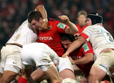 Peter O'Mahony gets to grips with the Saracens pack.