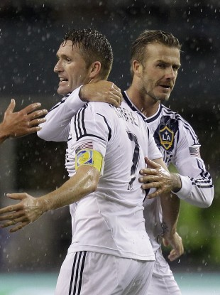 Los Angeles Galaxy's David Beckham and Robbie Keane celebrate.
