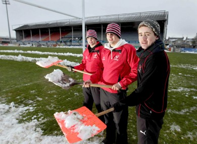Paddy Jackson, David McGuigan and James McKinney clear snow from the pitch at Ravenhill in 2010.