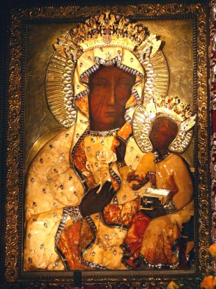 man throws paint at ancient catholic icon of virgin mary